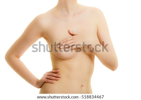 Health care, medicine, female controlling for cancer. Young topless woman covering her breast with hands isolated on white