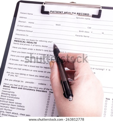 Health care person fills patient registration prior to admission and examination. The doctor is thorough in completing properly so the patient gets the optimal treatment during his examination  - stock photo
