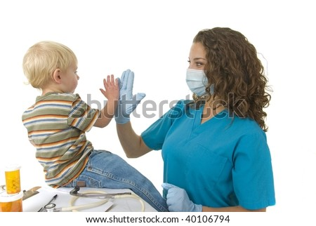 Health Care professional wearing gloves and mask completes medical check up or wellness check  and give toddler a high five - stock photo