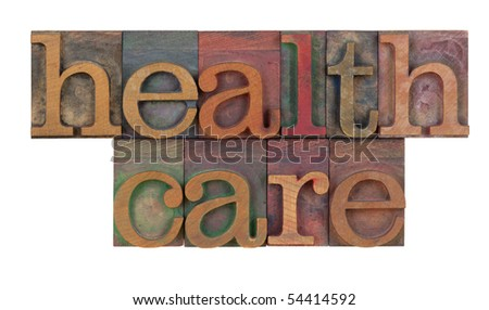 health care text or title in vintage wooden letterpress type blocks, stained by color ink, isolated on white