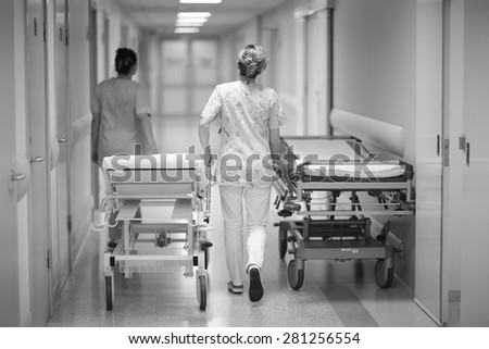 Health care worker's transporting emergency beds - stock photo