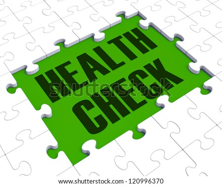 Health Check Puzzle Shows Health Care And Fitness - stock photo