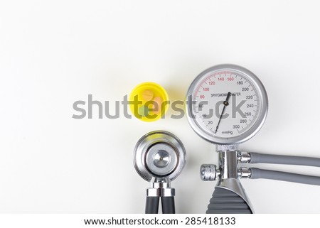Health checkup with blood pressure gauge and stethoscope