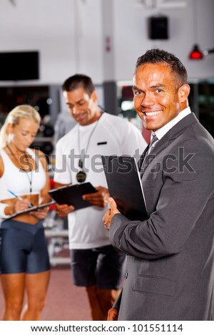health club manager and trainers - stock photo
