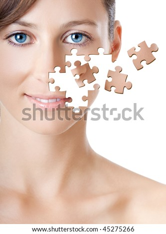 Health concept image - Beautiful young woman with puzzle pieces - stock photo