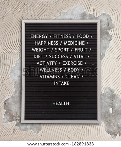 Health concept in plastic letters on very old menu board, vintage look