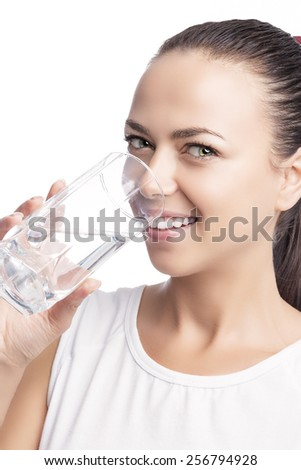 Health Concept: Portrait of Happy Smiling Caucasian Brunette Woman Drinking Clear Water from Glass. Isolated Over Pure White Background. Vertical Image - stock photo