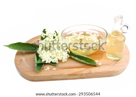 Health drink  from elderberry flowers on a white background - stock photo