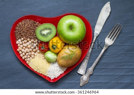 Health food on red heart plate  abstract diet still life