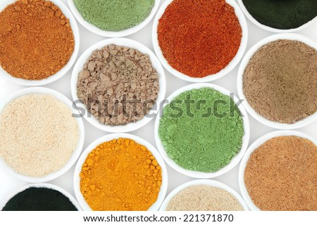 Health food powder superfood selection in white porcelain bowls. - stock photo