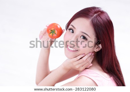 Health girl show tomato with smile face, health food concept, asian woman beauty - stock photo