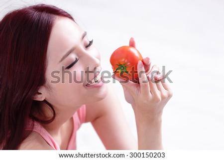 Health girl show tomato with smile face, health food concept, asian woman beauty