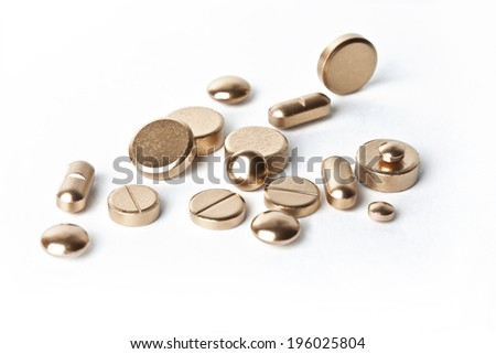 Health-gold. Golden pills. - stock photo