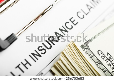 Health insurance application form with banknote concept for life planning