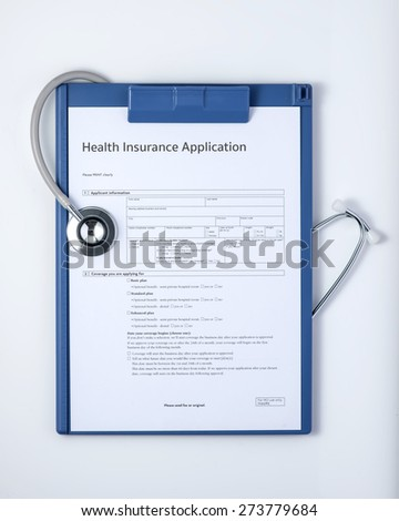 health insurance application with stethoscope. Isolated on white background. Medicine concept. View from above - stock photo