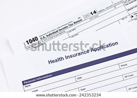 Health insurance application with 1040 US tax form. - stock photo