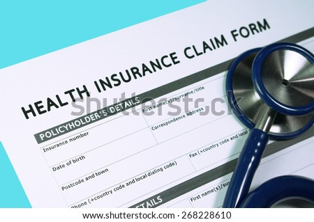 Health insurance claim form with stethoscope - stock photo