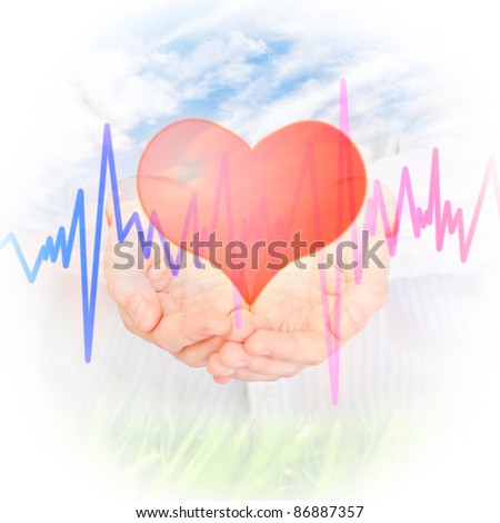 Health insurance concept. Hand and Heart - stock photo
