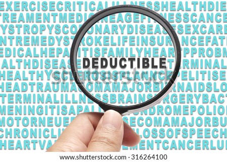 Health Insurance conceptual focusing on Deductible - stock photo