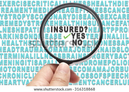 Health Insurance conceptual focusing on question, Insured? and the answer Yes - stock photo