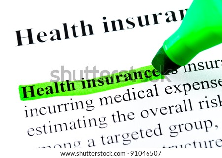 Health insurance definition highlighted by green marker on white paper background - stock photo