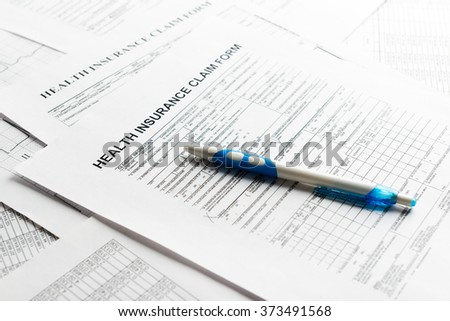health insurance form, paperwork and questionnaire for insurance concepts - stock photo
