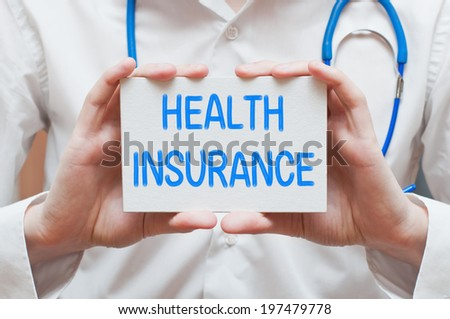 Health Insurance, medical concept. Physician shows information - stock photo
