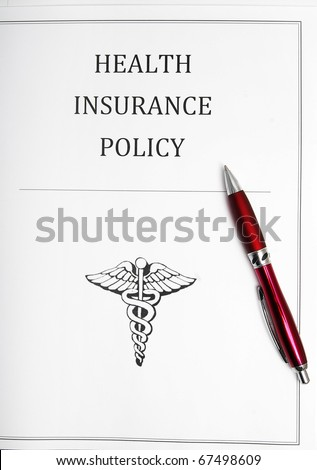 health insurance policy with pen - stock photo