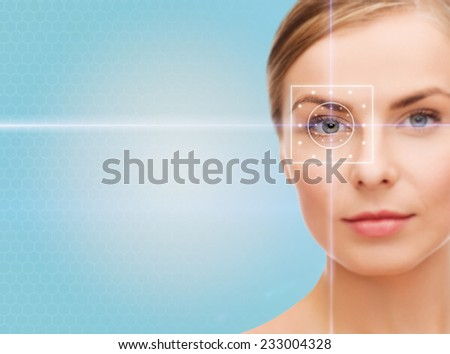 health, medicine, identity, vision and people concept - beautiful young woman with laser light lines on her eye over blue background - stock photo