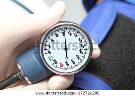 Health monitoring. Tonometer (sphygmomanometer) in the hands of a specialist - stock photo