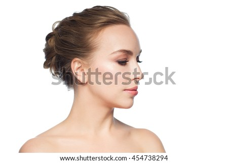 health, people, plastic surgery and beauty concept - beautiful young woman face over white background - stock photo