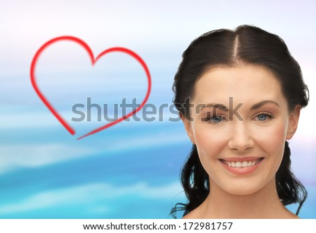 health, spa and beauty concept - clean face of beautiful young laughing woman
