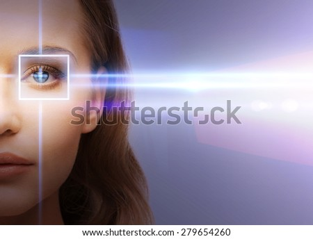 health, vision, sight - woman eye with laser correction frame - stock photo