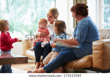 Health Visitor Talking To Mother With Young Children - stock photo
