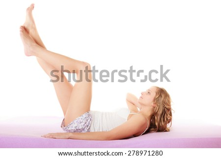 Health well being and  preventing varicose vein. Woman lying on her back in bed legs raised up high - stock photo