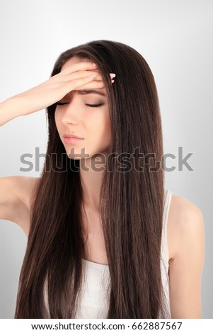 Health. Woman In Pain Feeling Bad And Sick, Having Headache And Fever, Holding Hand On Forehead. Beautiful Unhappy Tired Girl Suffering From Painful Head Ache And Stress. Healthcare. High Resolution