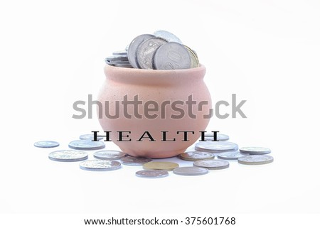 Health word with spend concepts coins in jar - stock photo