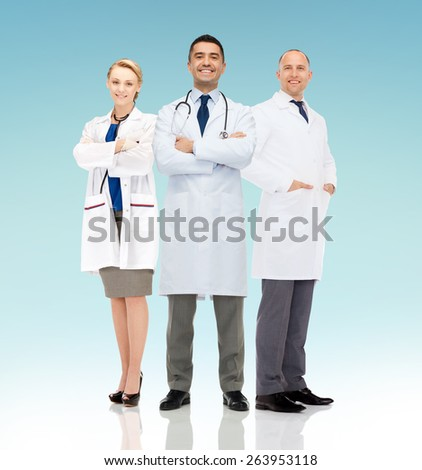 healthcare, advertisement, people and medicine concept - group of smiling doctors in white coats over blue background - stock photo