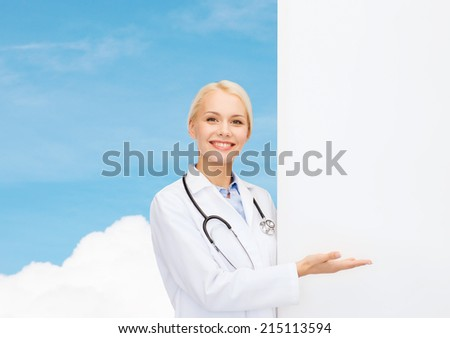healthcare, advertisement, people and medicine concept - smiling female doctor with stethoscope showing something over blue sky background - stock photo
