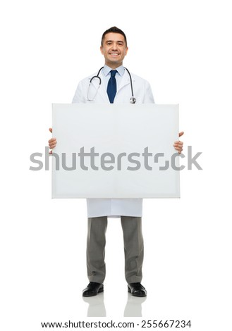 healthcare, advertisement, people and medicine concept - smiling male doctor in white coat holding white blank board