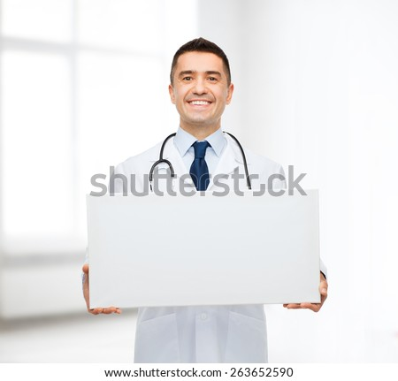 healthcare, advertisement, people and medicine concept - smiling male doctor in white coat holding white blank board over hospital room background - stock photo