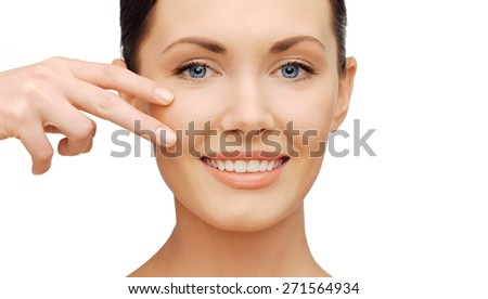 healthcare and beauty concept - beautiful woman touching her cheek skin