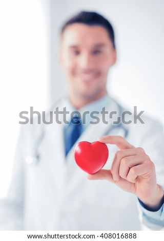 healthcare and medical concept - male doctor with heart - stock photo