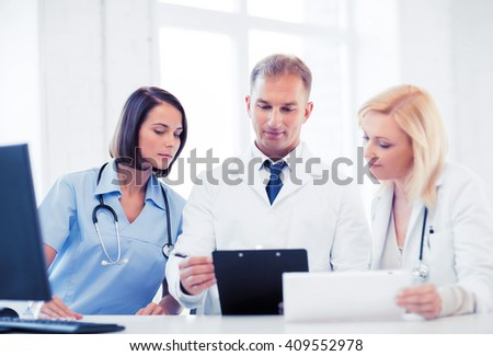 healthcare and medical concept - team or group of doctors on meeting - stock photo
