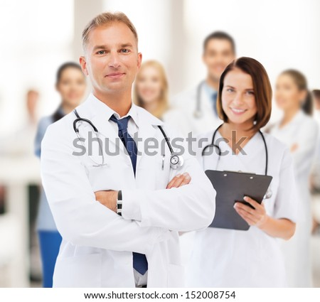 healthcare and medical concept - two doctors in hospital - stock photo