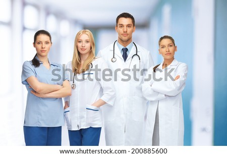 healthcare and medical concept - young team or group of doctors - stock photo