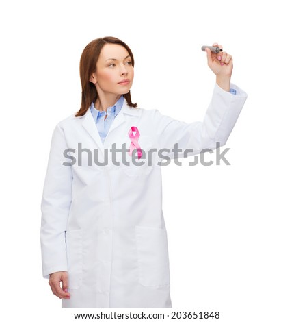 healthcare and medicine concept - female doctor with pink breast cancer awareness ribbon writing something in the air - stock photo