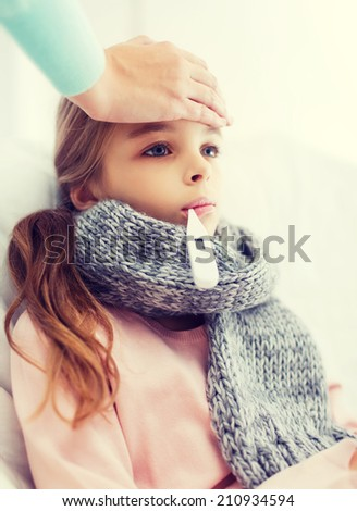 healthcare and medicine concept - ill girl child with thermometer in mouth and caring mother - stock photo