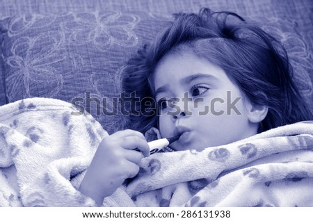 Healthcare and medicine concept - ill girl child with thermometer in mouth.(BW) - stock photo