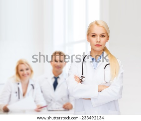 healthcare and medicine concept - serious female doctor with stethoscope - stock photo